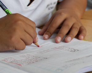 child working on a maths problem